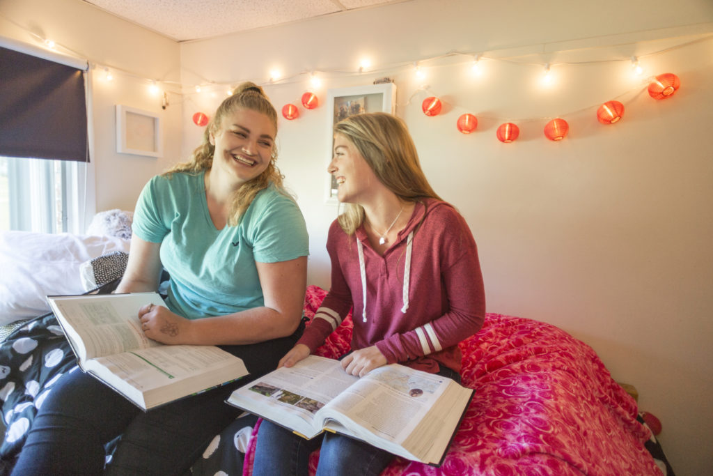 Two female students studying in the apartments on the Central Maine Community College campus.