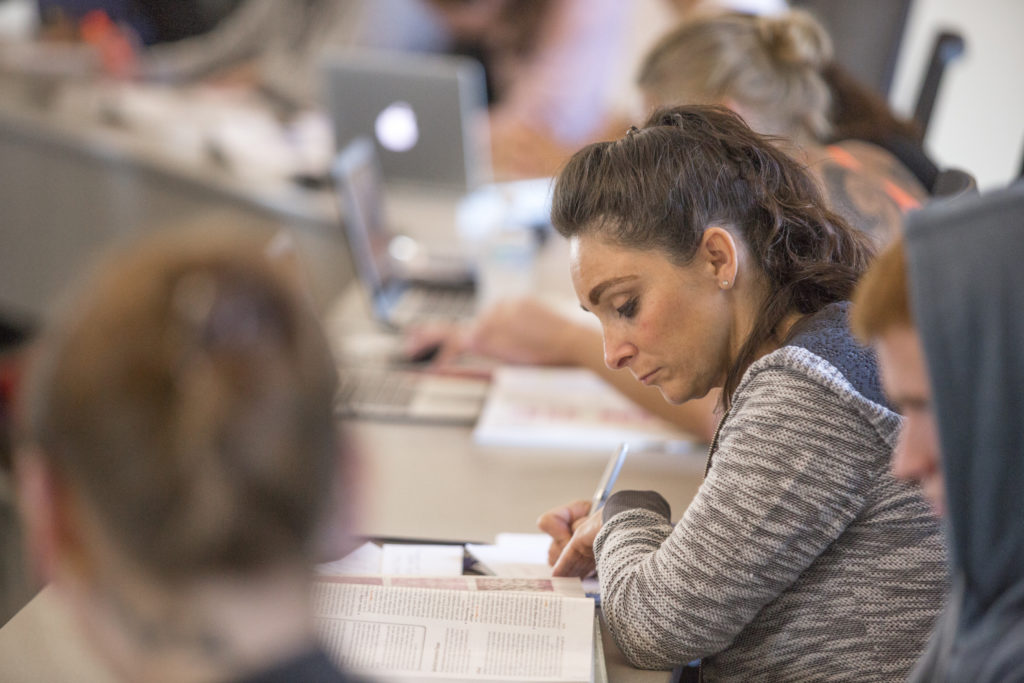 A female participates in a lecture hall at Central Maine Community College