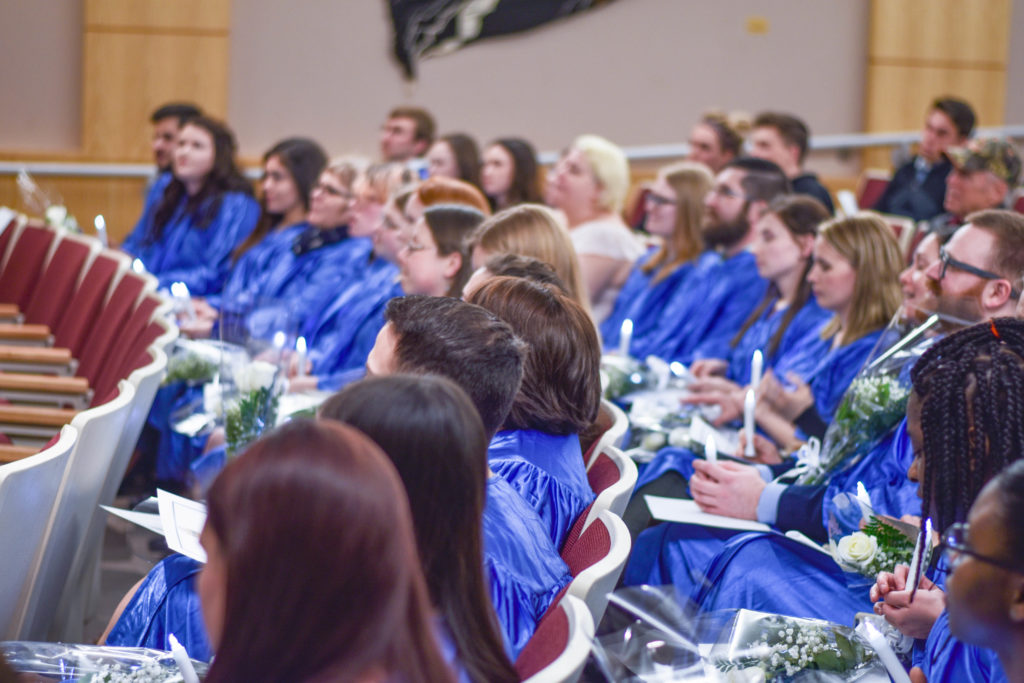 A large group of students in blue robes participate in the Phi Theta Kappa Honors Society spring 2017 Induction. These individuals have achieved high academic goals.
