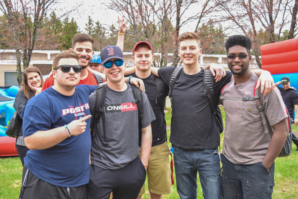 Six young men enjoying Spring Fling, an annual fun event put on by Student Senate