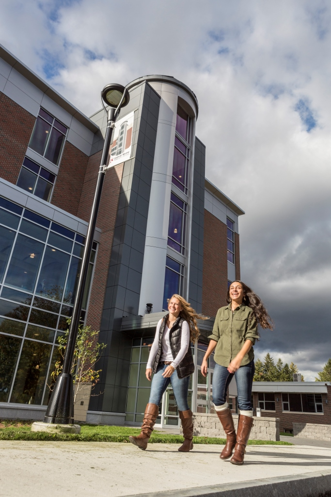 "Students walk past The Tower on the campus of Central Maine Community College. The ""late start"" semester option at the college starts September 24."