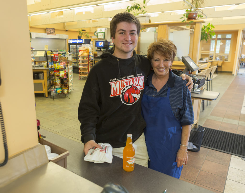 A male student poses with a female staff member of the dining commons. Many students create close relationships with staff members here!