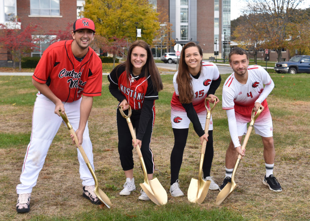 Breaking ground for the new athletic complex at Central Maine Community College are left to right student athletes Nick L'Heureux, Samantha Belardo, Keara Hunter, and Cody Dolloff. The synthetic turf facility will include baseball and softball diamonds and a soccer field.
