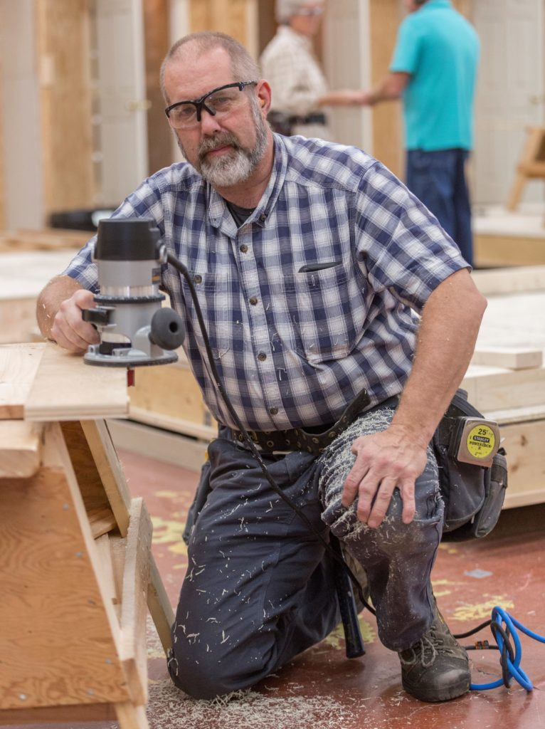 """""""Doc' Hannaford scholarship winner Leon Twitchell poses while at work in the Building Construction Technology lab at CMCC."""