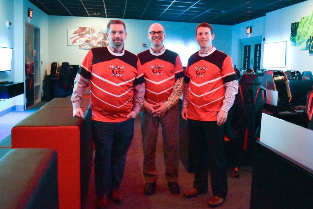 Carbonite officials donned official jerseys for this photo taken in the Esports Arena at CMCC. Left to right are Rob Frost, vice president of customer care; Brett Siedman, senior director of customer care; and Tom Neal, senior manager of recruiting.