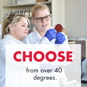 "Two white women with blond hair in white lab coats in a science lab holding a bacteria sample up to review it. Text overlay reads ""Choose from over 40 degrees"""