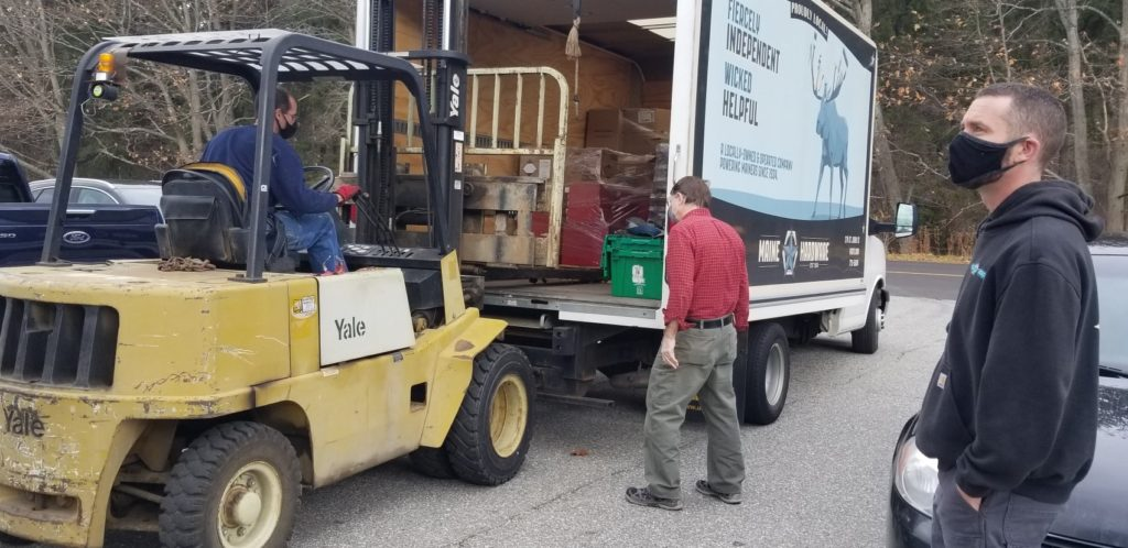 Truck filled wtih donations from Maine Hardware with masked students and instructors.